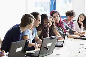 Photo of young people in class
